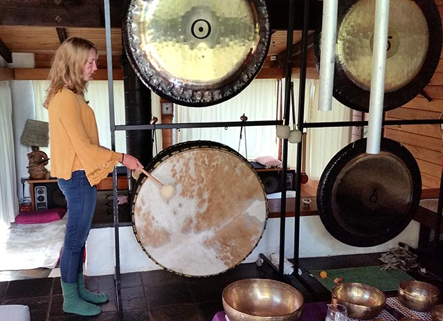 Amber playing the gong drum